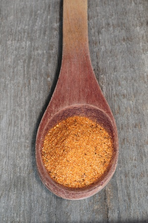 Spice pile in spoon  Stock Photo