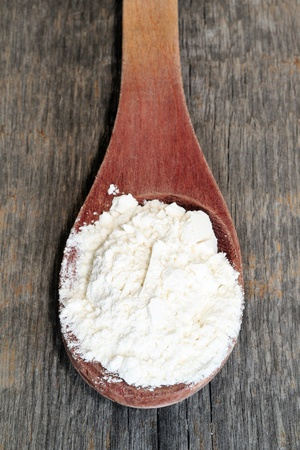 Whole flour in spoon Stock Photo - 18486519