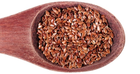 Linseed in wooden spoon  Stock Photo