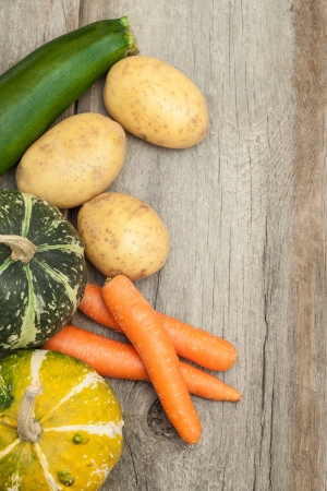 Vegetables on a wooden background  photo