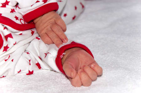 Newborn baby's pen close-up on white background. Stok Fotoğraf