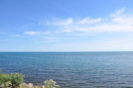 Blue sea and clouds on sky. Stok Fotoğraf