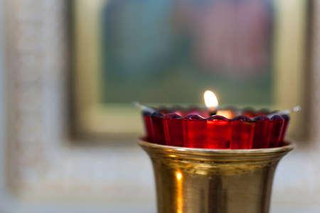 One candle flame at night closeup. Stok Fotoğraf