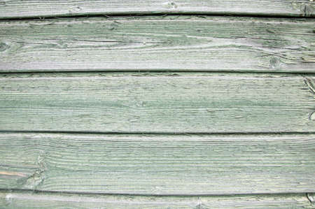 Old green painted wood wall. Beautiful texture or background.