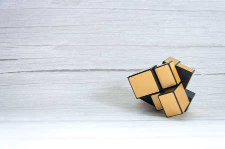 Cube on a wooden table background. Stok Fotoğraf