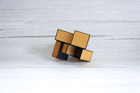 Cube on a wooden table background. Stock Photo