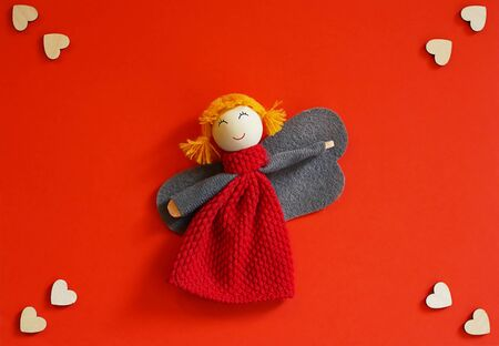 angel girl with hearts on a red background. Mothers Day, Valentines Day,