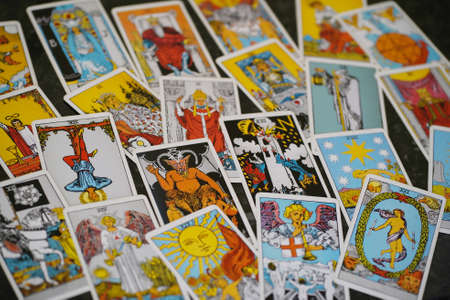 pile of tarot cards jumbled, scattered and haphazardly arranged. Editorial