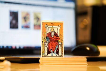 Defocused illustrative editorial tarot cards.