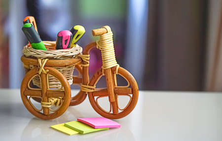 Education learning concept with multicolored felt pens, bike