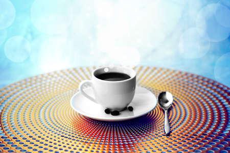 Blurred Blue background of cup of Black Coffee, defocused light