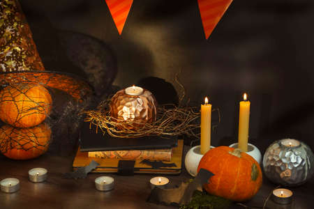 Blurred Helloween composition with pumpkins and candles. High quality photo