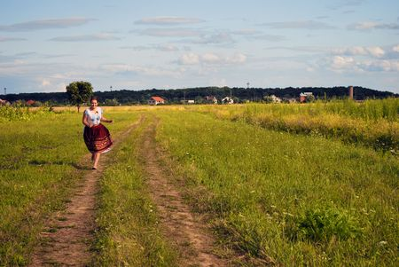 She is run to You! This happy girl is run cross the field. Stock Photo - 5988871