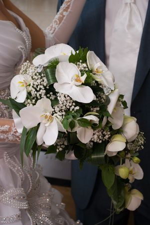 lustre: Blide hold the bouquet from orchids