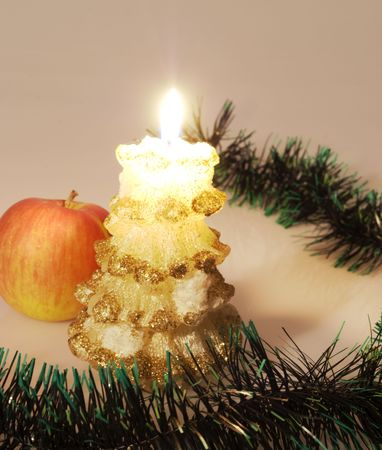 decored christmas candle and red apple photo