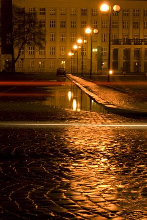 Night city after rain and puddle raflection photo