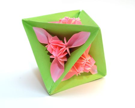 Colorfull origami unit triangle pink flower isolated on white background photo