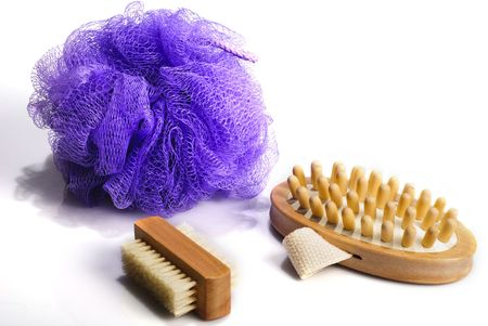 Bath anti-cellulitis spa massage kit with comb, brush and violet sponge isolated on white background. With  shadow. Stock Photo - 6300567