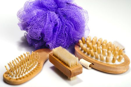repertoire: Bath anti-cellulitis spa massage kit with comb, hairbrush, brush and violet sponge isolated on white background. With  shadow.