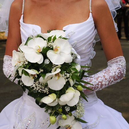 arm bouquet: Bride hold the bouquet from orchids Stock Photo