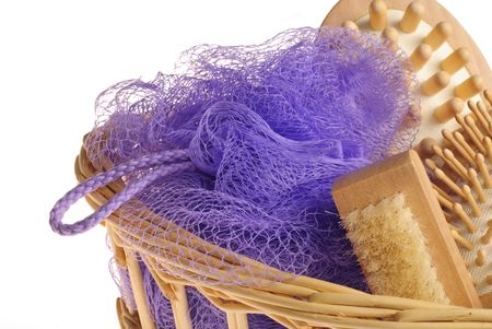 repertoire: Bath anti-cellulitis spa massage kit with comb, brush, sponge and hairbrush in basket isolated on white background  Stock Photo
