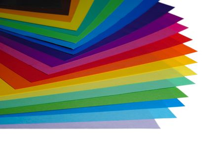 descriptive colour: various color paper stack like a rainbow isolated on white