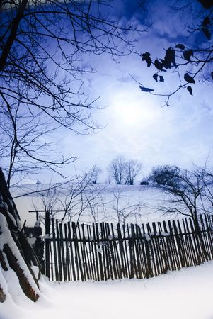 Rural winter mountain landscape with sundown and road, trees, fence Stock Photo - 6408005