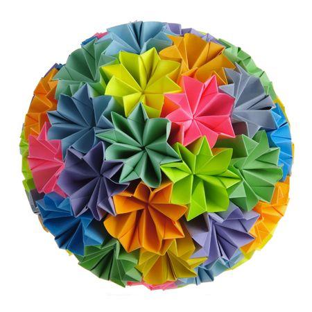 Colorfull origami kusudama from rainbow flowers isolated on white photo