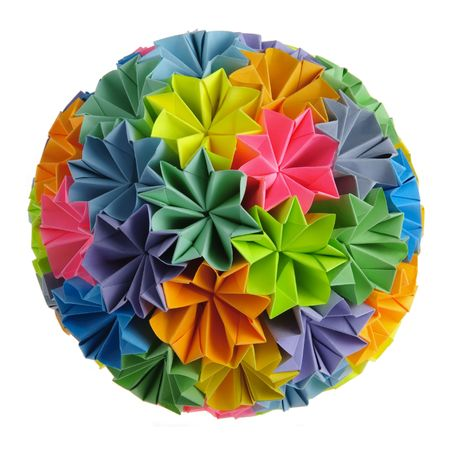 Colorfull origami kusudama from rainbow flowers isolated on white photo