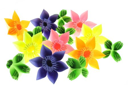 Colorfull origami flowers and leafs from paper isolated like garden on white photo