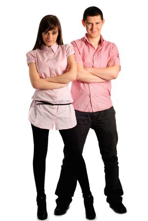 Couple dressed in pink clothes isolated on white with crossed legs. photo