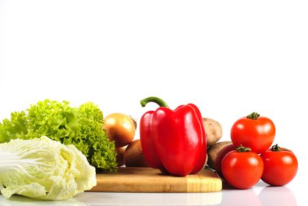 hardboard: Vegetables on hardboard in kitchen for salad, isolated on white
