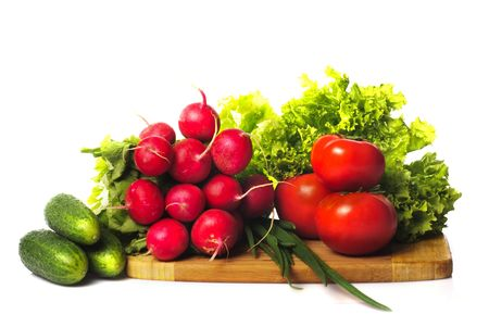 Vegetables in kitchen for salad on wooden hardboard, isolated on white Stock Photo - 6910009
