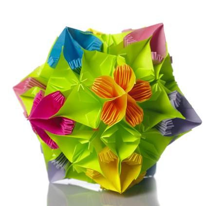Colorfull origami kusudama from rainbow flowers isolated on white.  photo