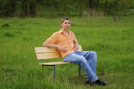 pensiveness: Man on bench in park. Shallow DOF. Outdoor portrait Archivio Fotografico