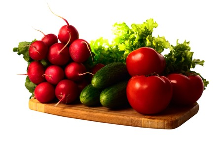 Vegetables in kitchen for salad on wooden hardboard, isolated on white photo