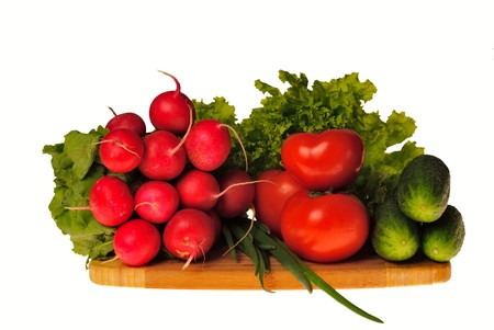 Vegetables in kitchen for salad on wooden hardboard, isolated on white Stock Photo - 7186008