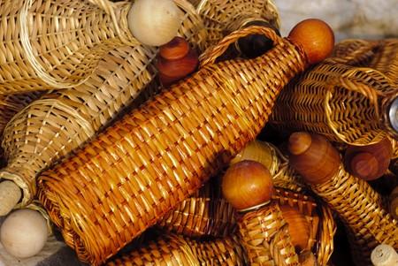 spliced: Basketry market on nature. Wicker cover for bottles.