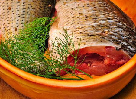 Fish carcass with spices on wooden hardboard, prepared for cooking Stock Photo - 7258850