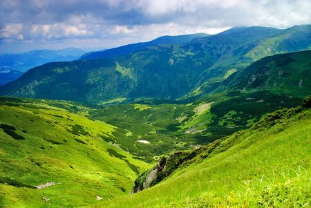 Beautiful mountains landscape with lake and clouds in Carpathian mountains