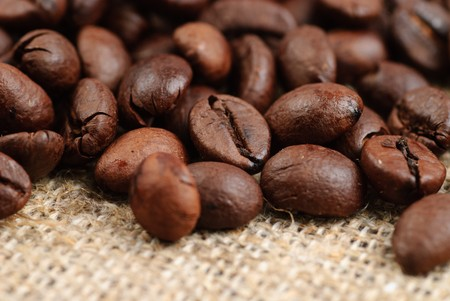 bagging: Coffee beans on the bagging. Selective focus, close up Stock Photo