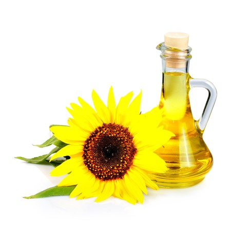 sunflower seed oil isolated on white background photo
