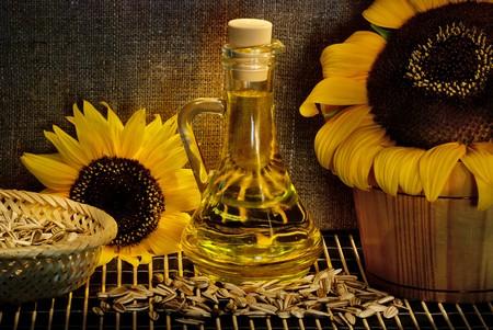sunflower seed oil still life, light painting photo