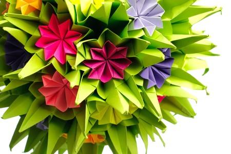 Colorfull origami kusudama from rainbow flowers isolated on white. Close up. photo