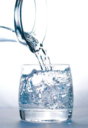 water jug: Pouring water into the glass from jug