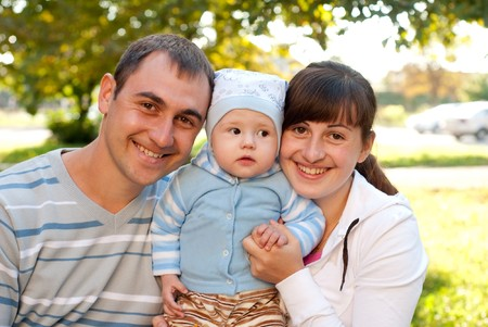 Happy family outdoor - mother, father and son are smiling Stock Photo - 7768618