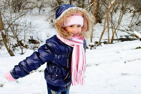 Girl outdoor are playing with snow outdoors Stock Photo - 7878297