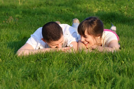 pensiveness: Couple lie on the grass and look up. Shallow DOF. Outdoor portrait Archivio Fotografico