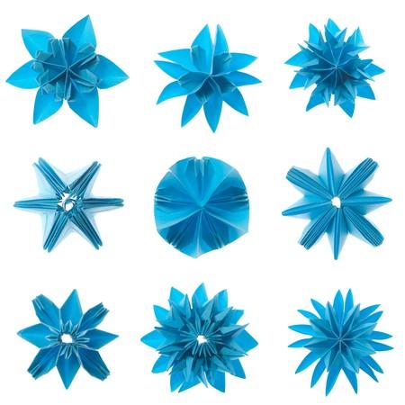 Nine blue origami units snowflake set isolated on white background photo