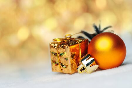 christmas things as ctrobiles and gold present and ball on white photo